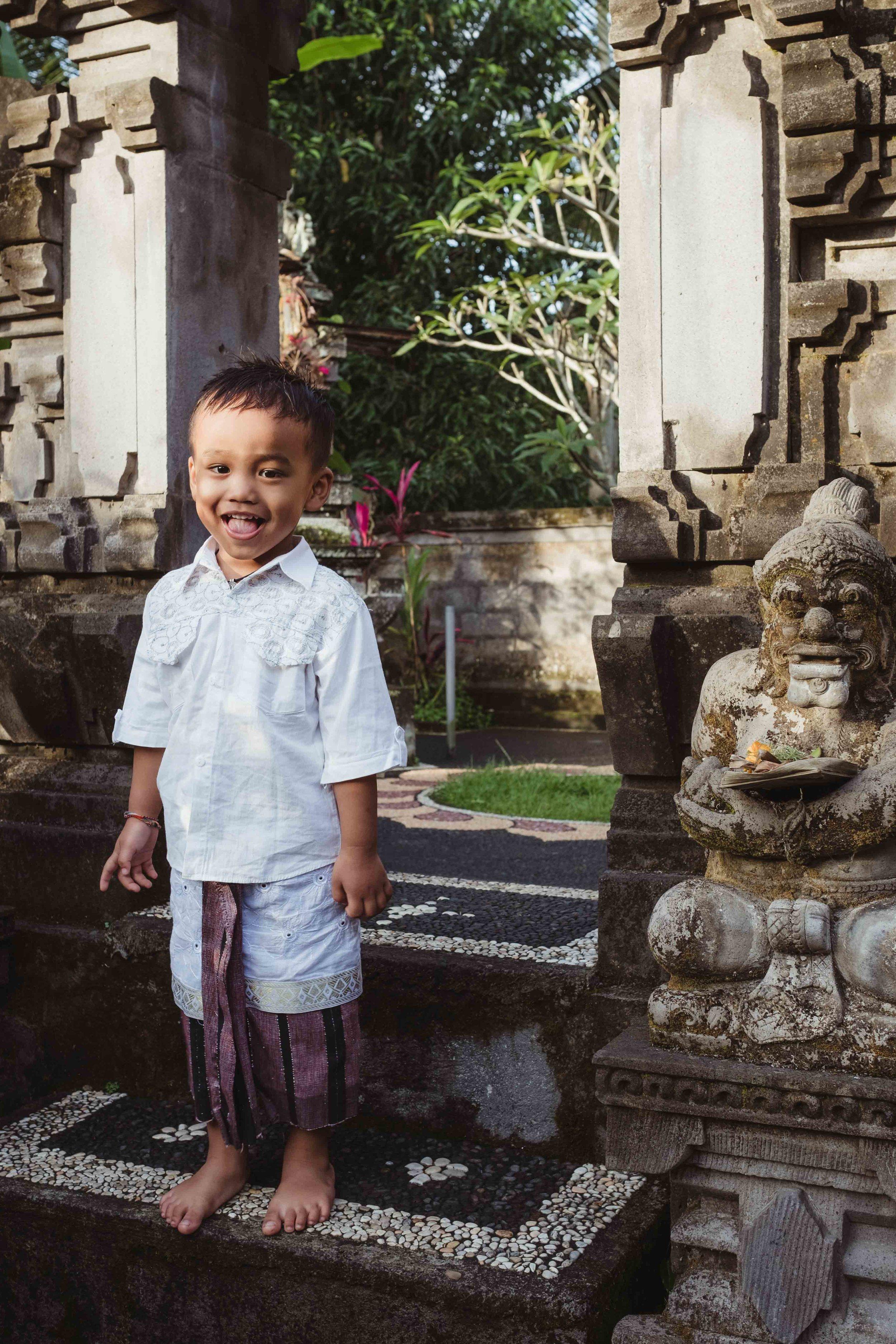 boy outside family temple