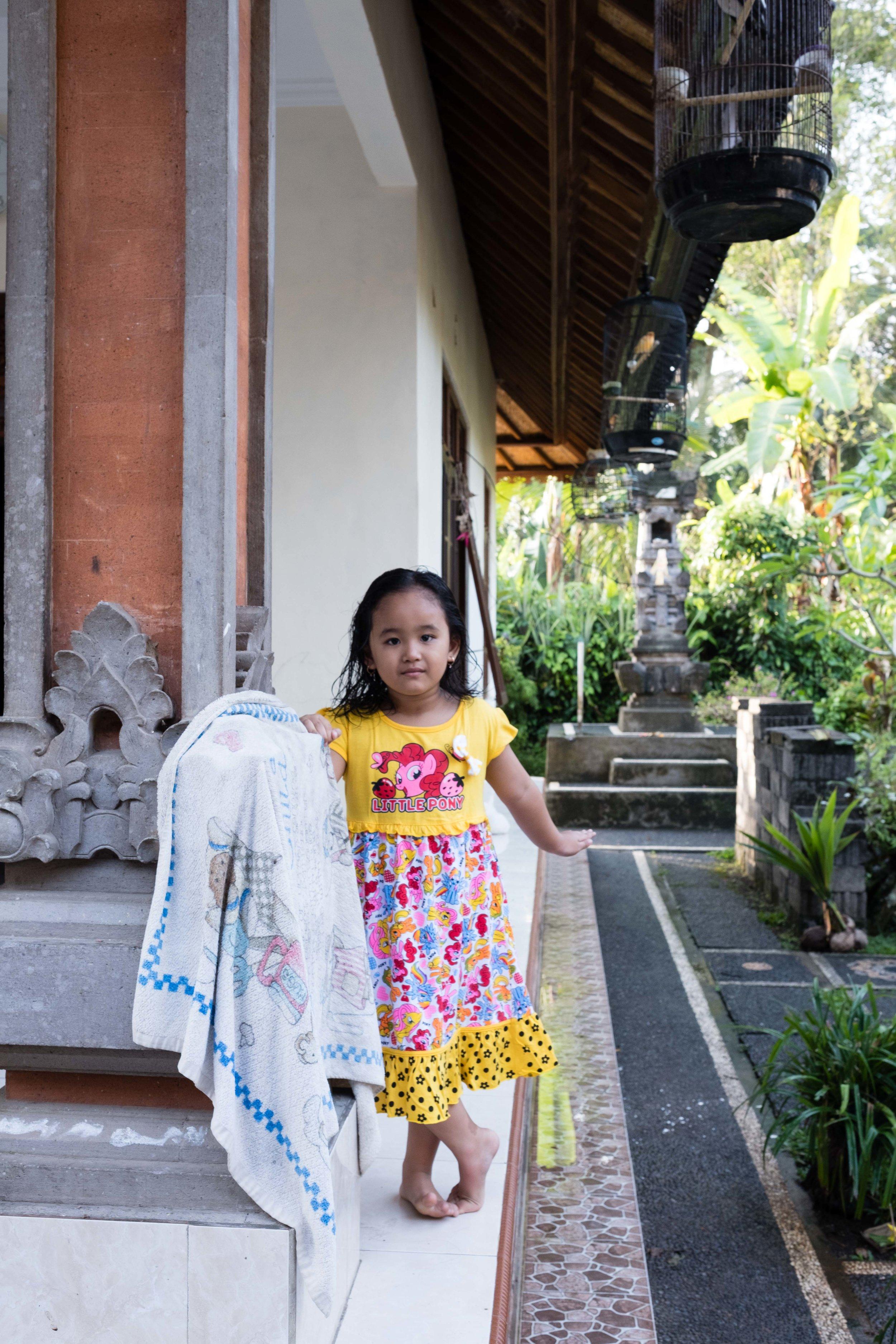 Little girl outside family home
