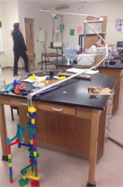 Physical Science: The assignment, Marble in Motion, using a marble and any materials from home or in class–Construct a model to demonstrate all 3 laws of motion, 3 forms of friction, and a change in velocity. This was an awesome hands on approach. My students had a fun time with it!