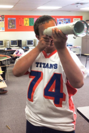 She barely has any funding, but rounded up enough to make home-made telescopes for her 8th graders!