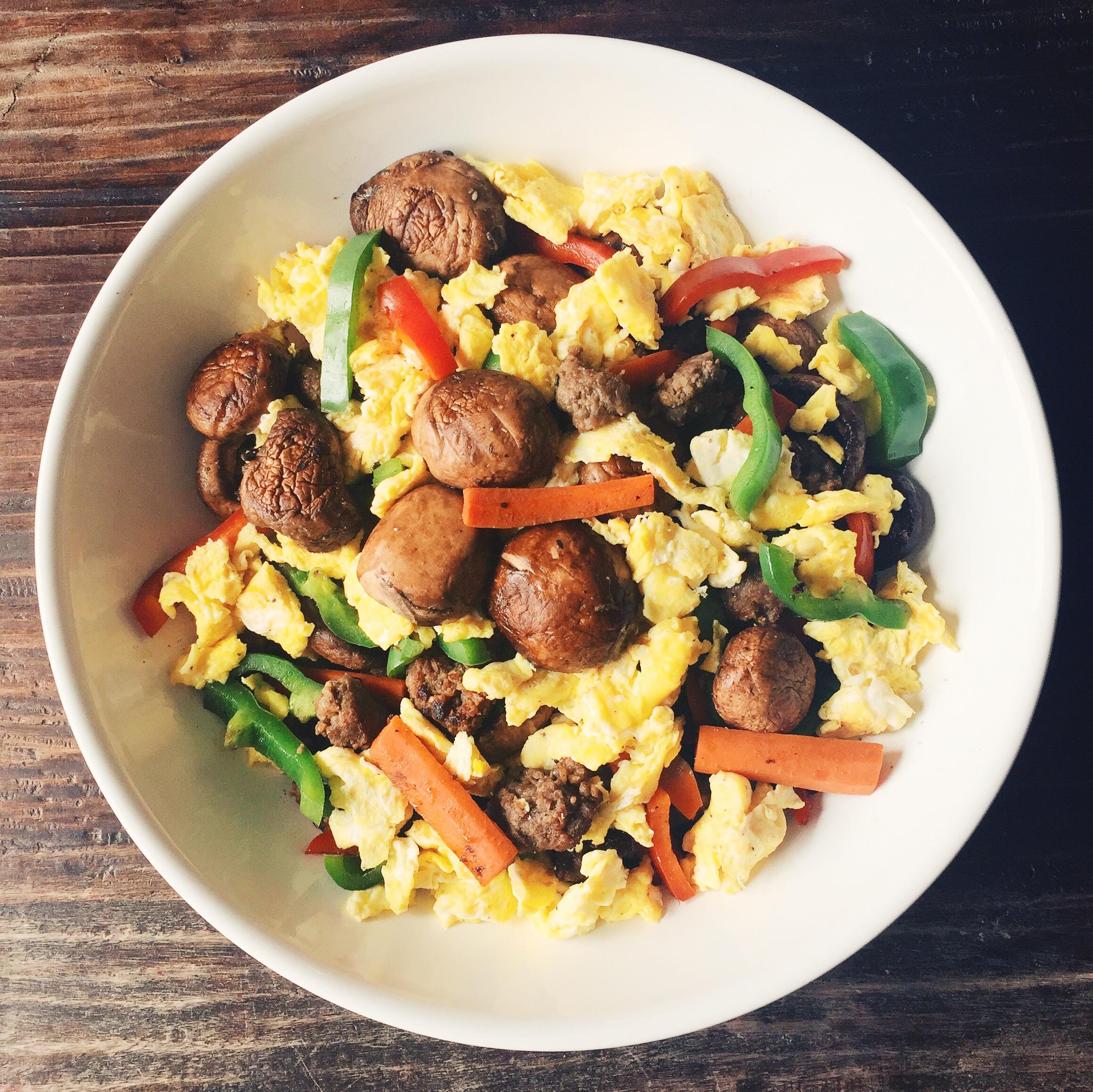 Leftover veggies over scramble eggs for breakfast