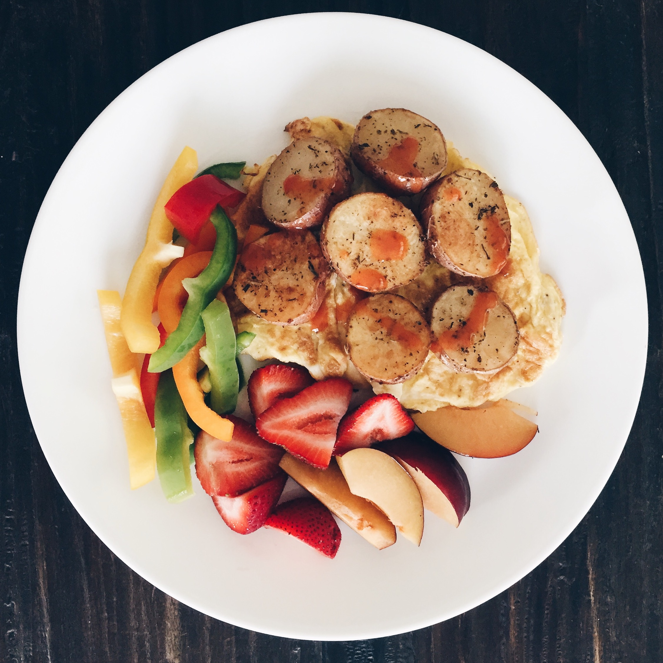 This is my very easy scrambled eggs with roasted potatoes, fruit, and veggies.