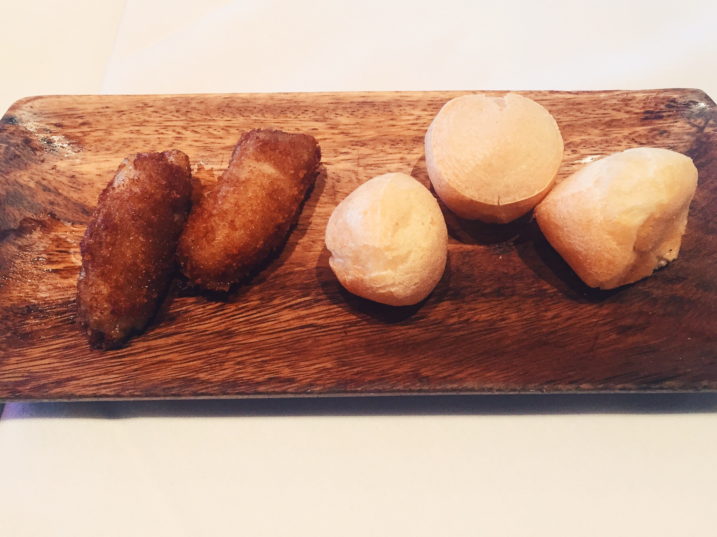Traditional Brazilian appetizers - fried plantains and cheese bread.