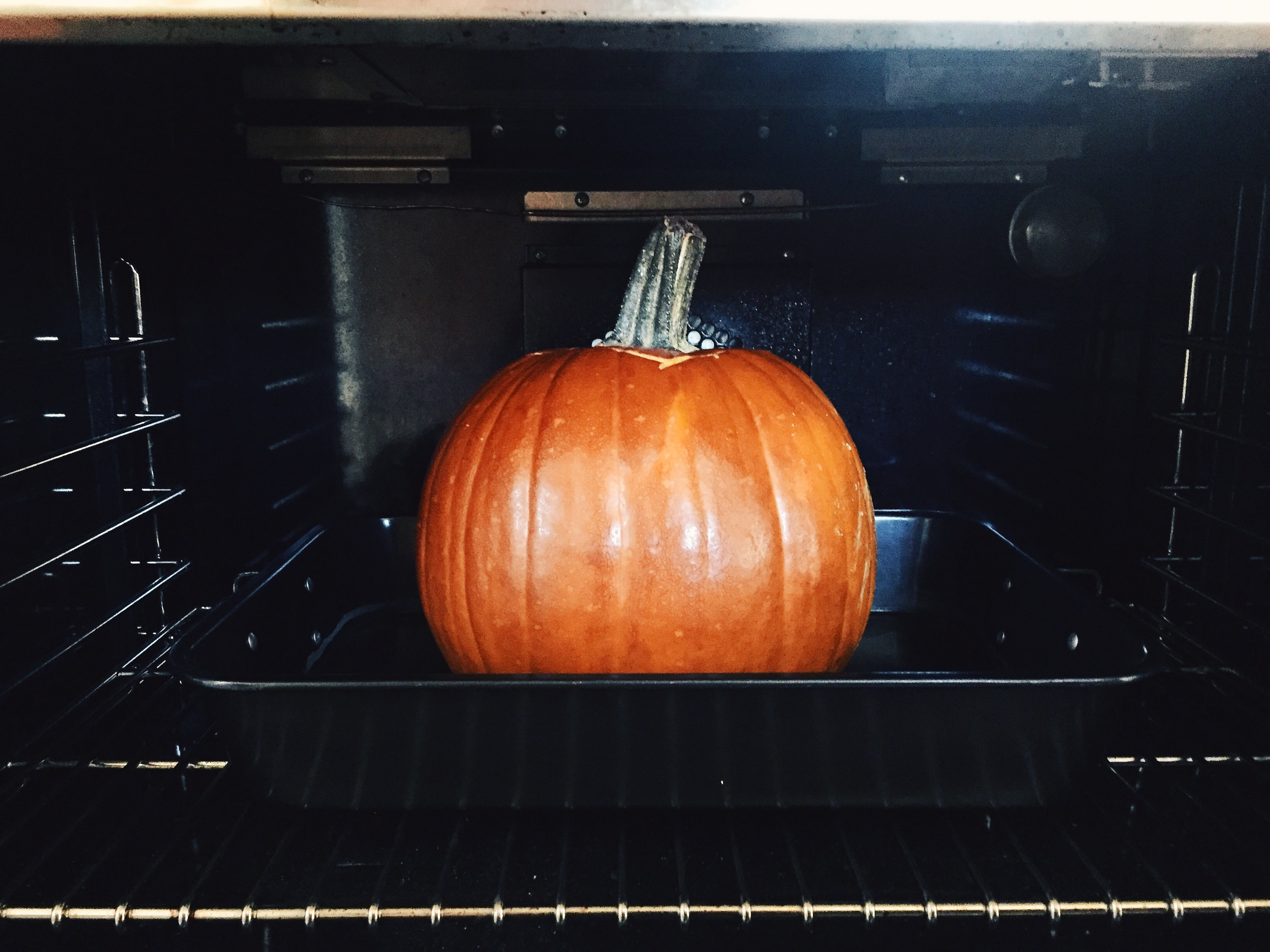 Half way. Check pumpkin frequently to be sure there is always water in the pan