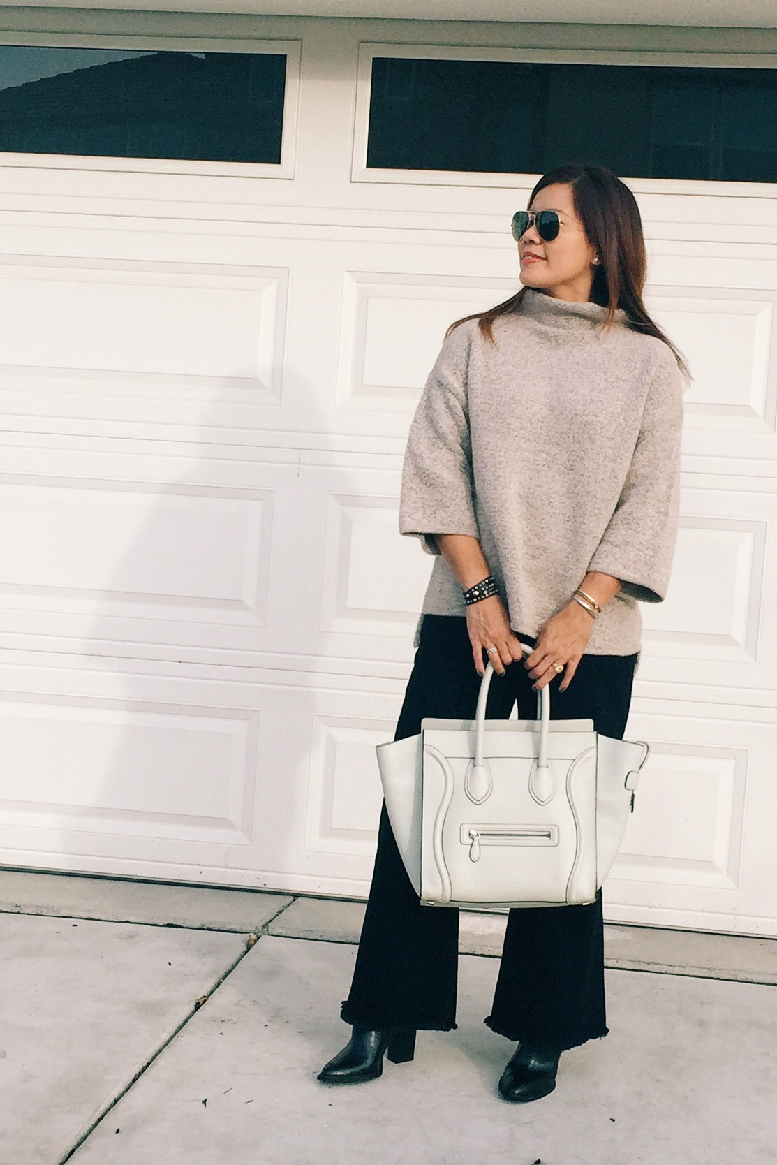 Sweater  and  pants  from Zara.