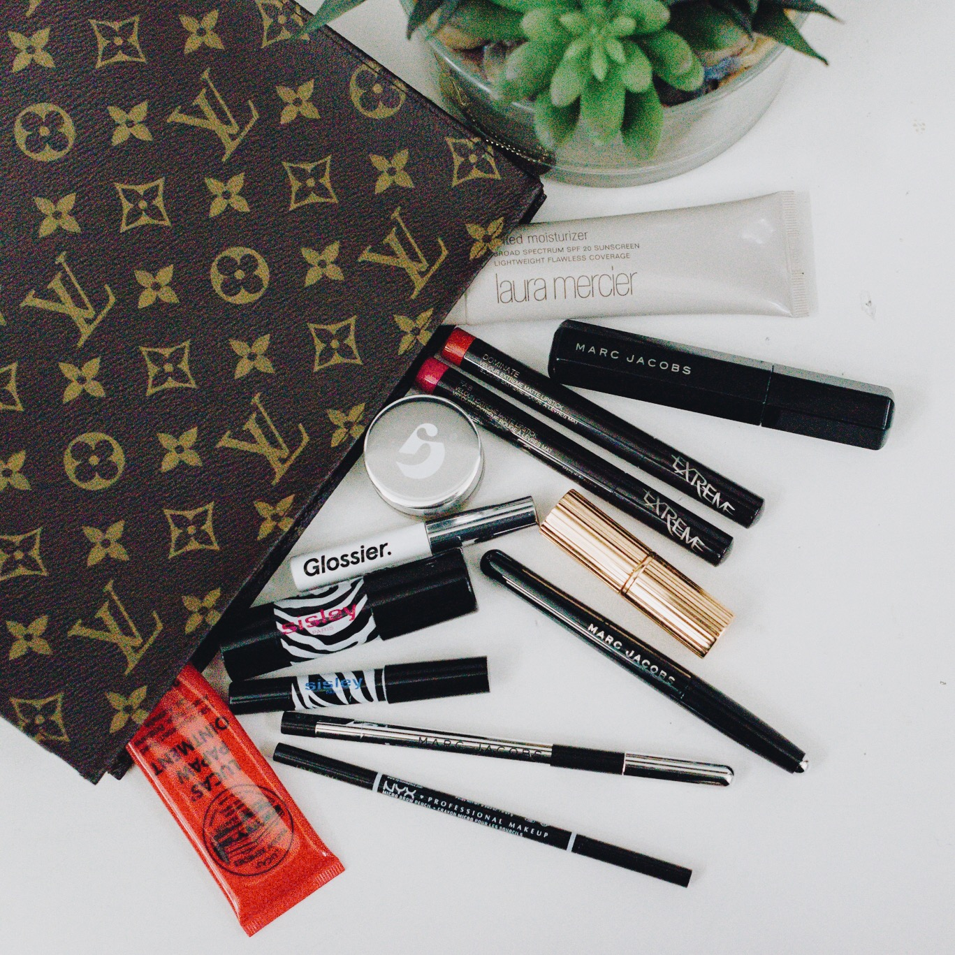 momlikethat - what's in my makeup bag.JPG