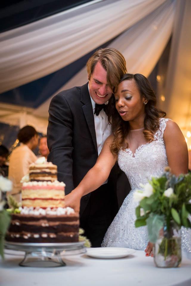 couple-cutting-the-cake-wedding-reception.jpg