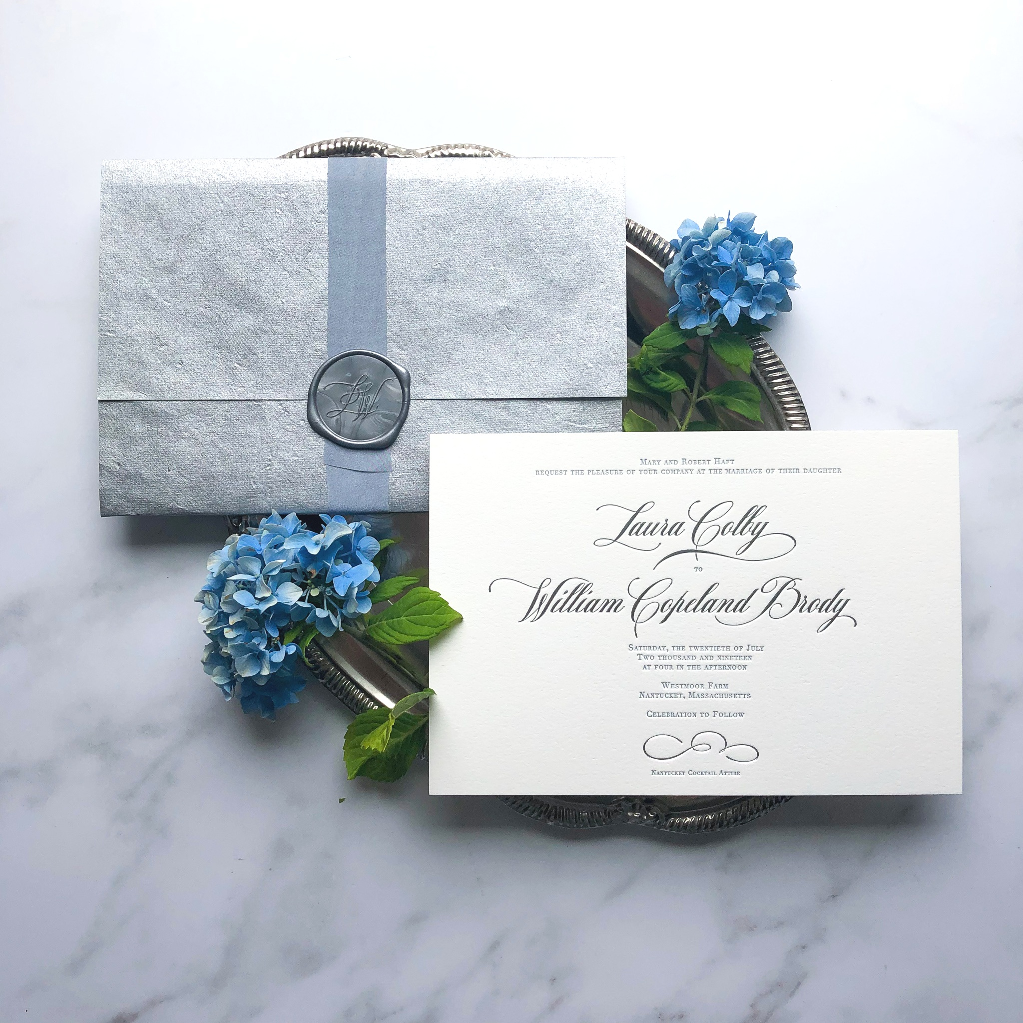 Features Shown: monogram wax seal, handmade specialty silver paper, letterpress, & silver foil stamping