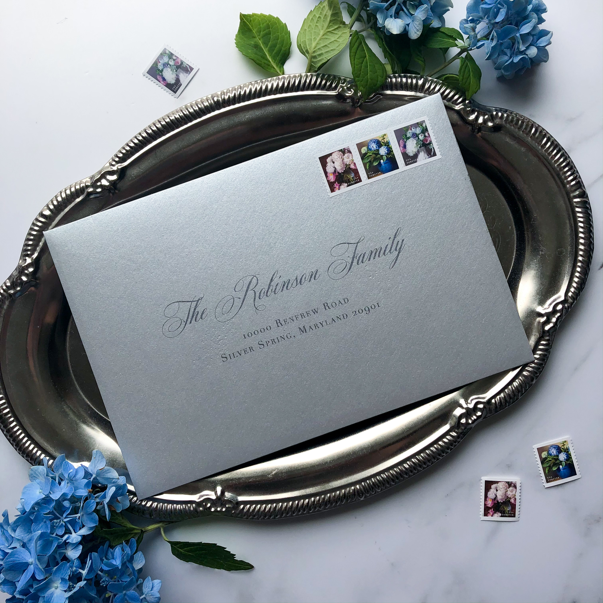 TypeAInvitations_Nantucket_SilverBlue_Wedding_Printed-AddressedEnvelopes_Silver_Stamps.jpg