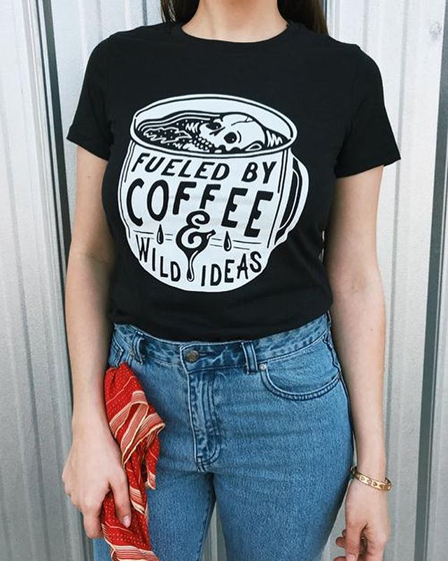 The fueled by coffee design I drew for @mindzaiapparel is available on women's tees and pocket prints over at MindzaiApparel.net 💀☕️
