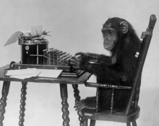 Chimpanzee_seated_at_typewriter.jpg