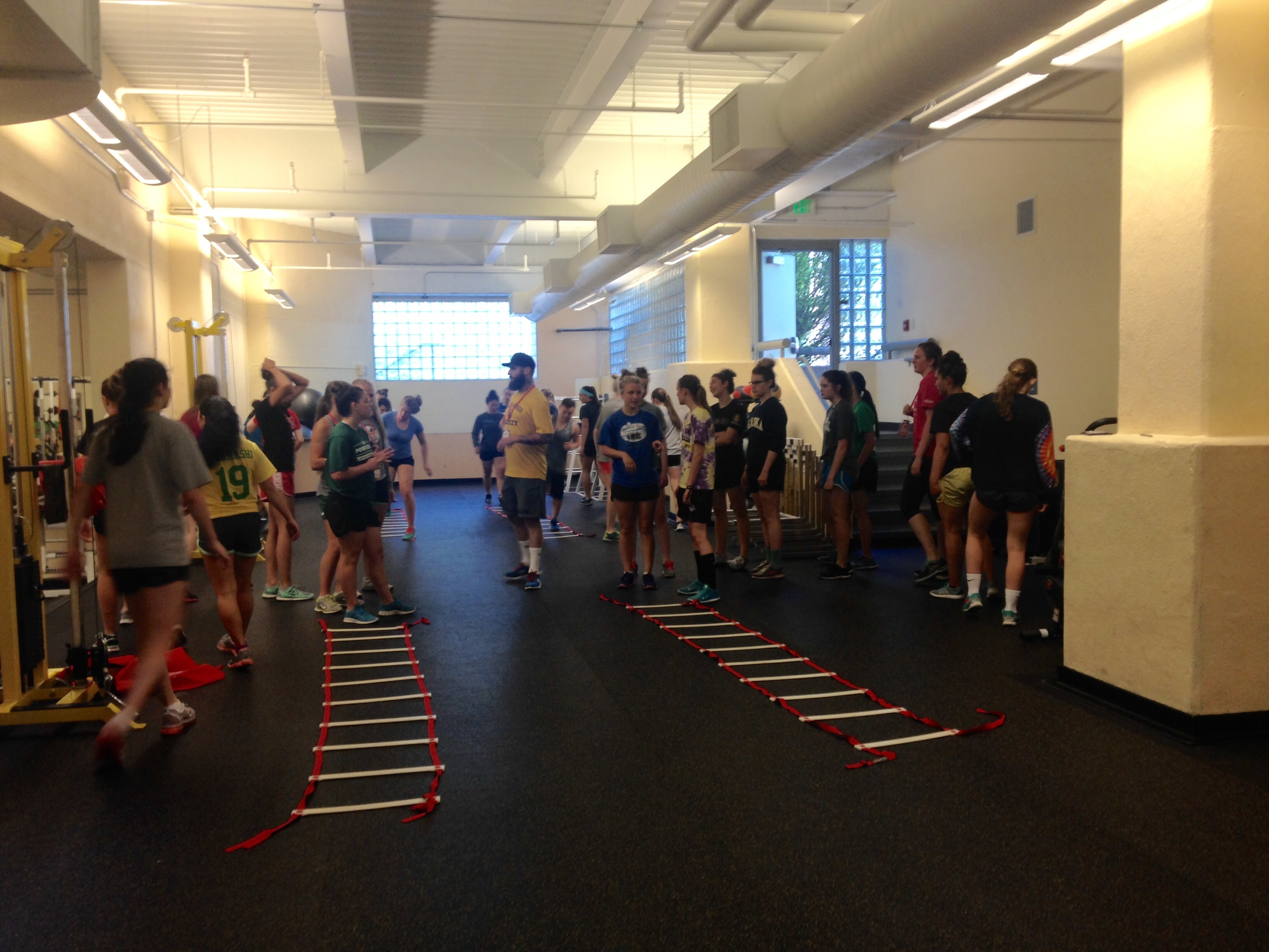 Cody Lampl, putting the girl's through some agility ladder training.