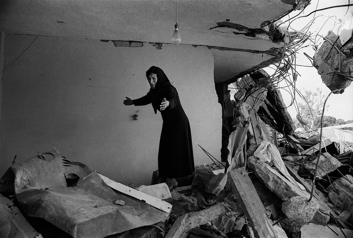 A-Palestinian-Woman-returning-to-the-ruins-of-her-house-Sabra-Beirut-1982.jpg