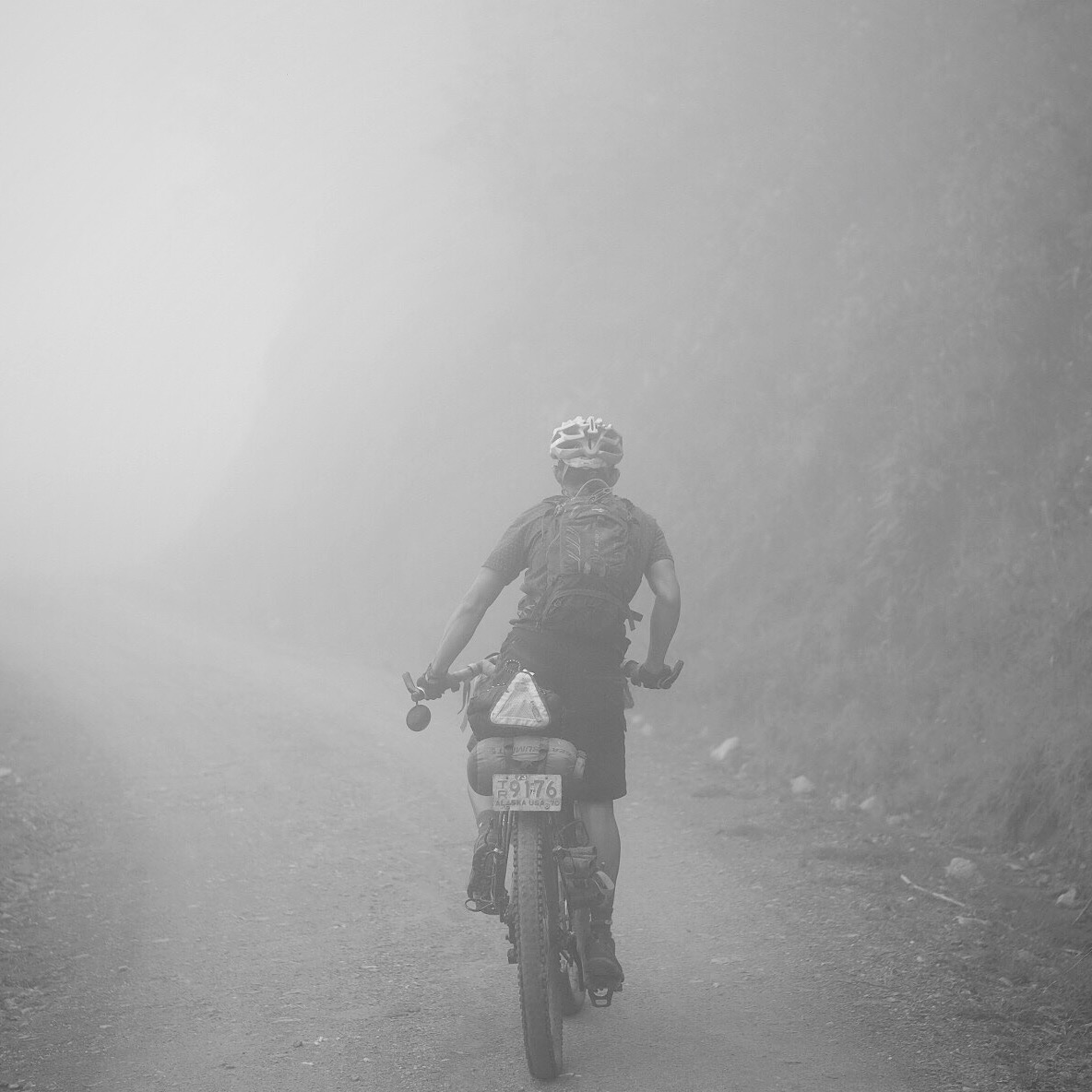 Dean  going through the mist during our 20km climb on the way to Toche.