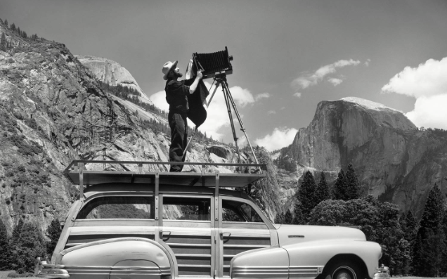 Ansel Adams   photographing in Yosemite. This is one of the photographs I was happy to buy at his gallery inside the park.