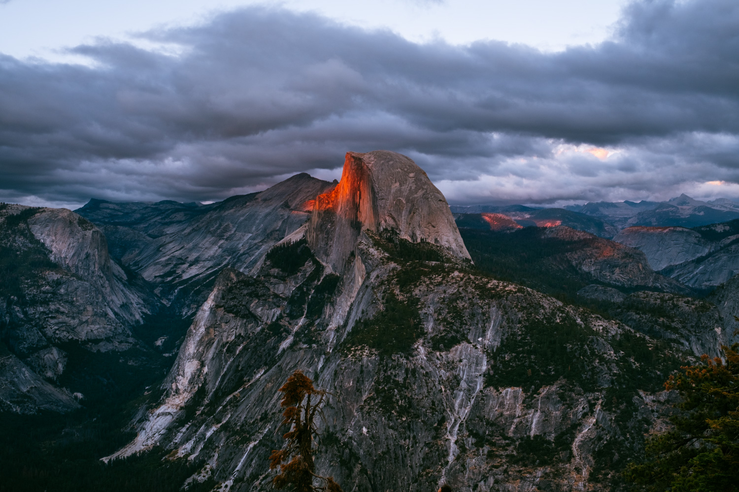 Half Dome painted in red by the warm rays of sunlight