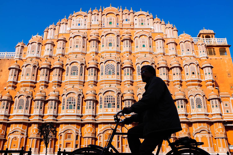 A man cycling past  Hawa Mahal , Jaipur,  India