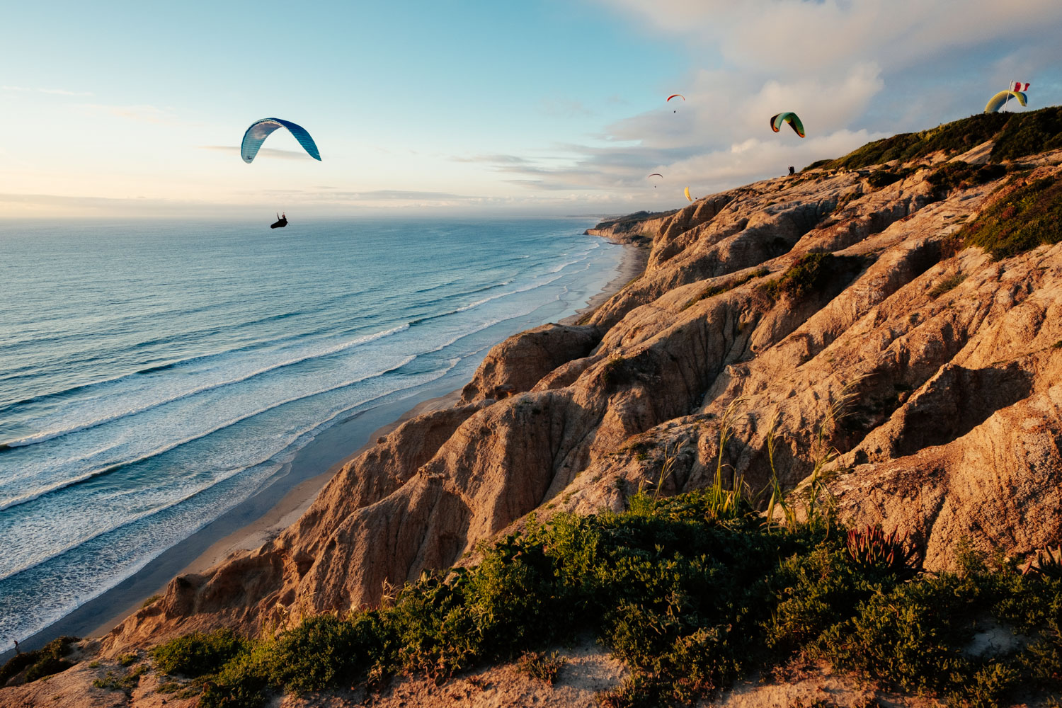 Paragliders flying above Torrey Pines State Reserve, San Diego, CA.