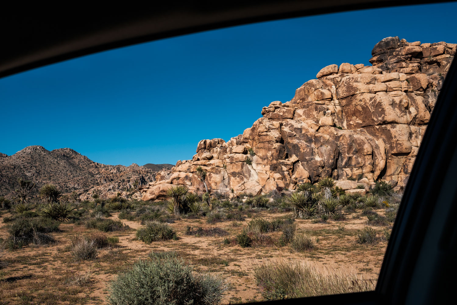 Gorgeous rock formations framed by our car's window