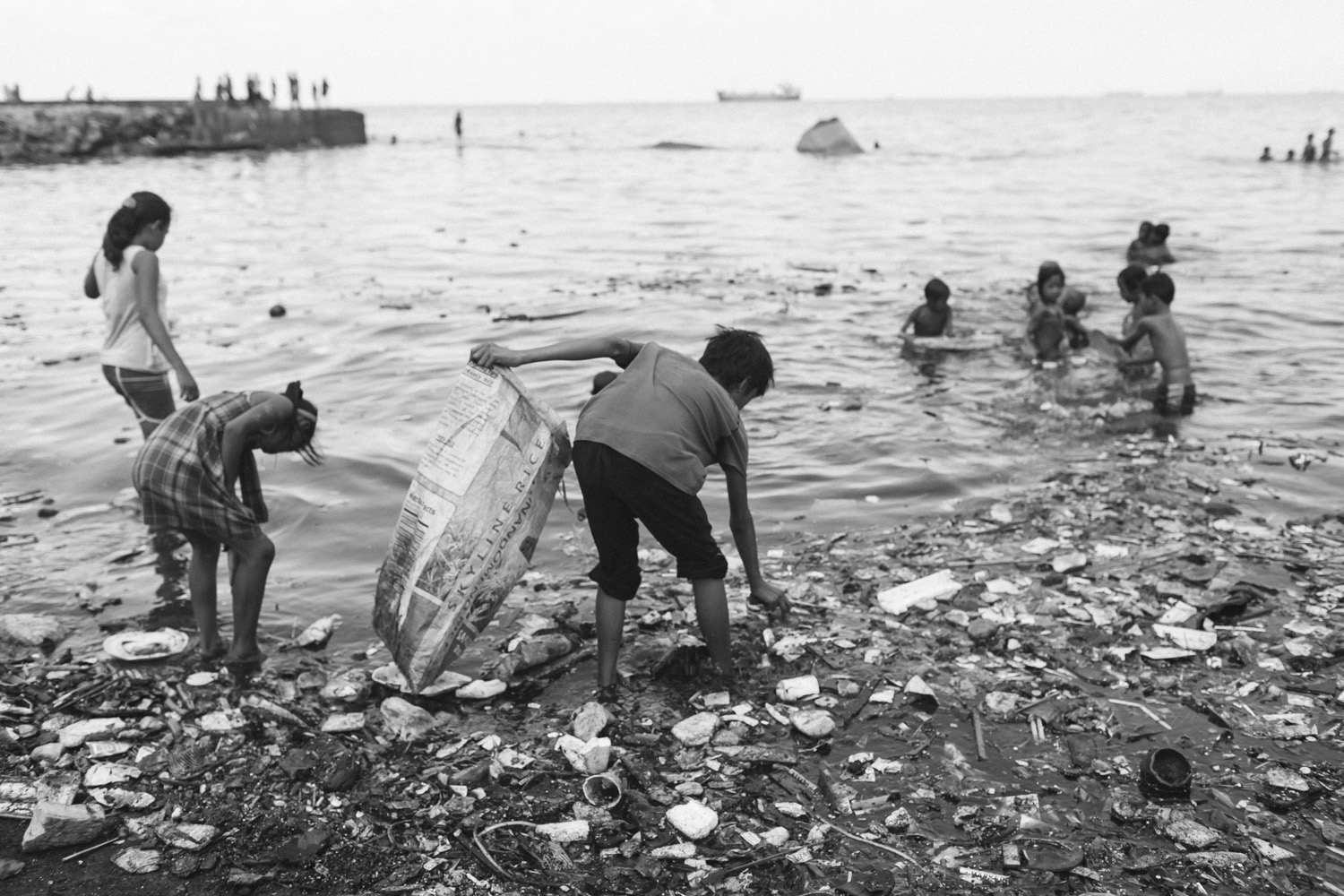Children looking for plastic in Tondo, Manila - Philippines
