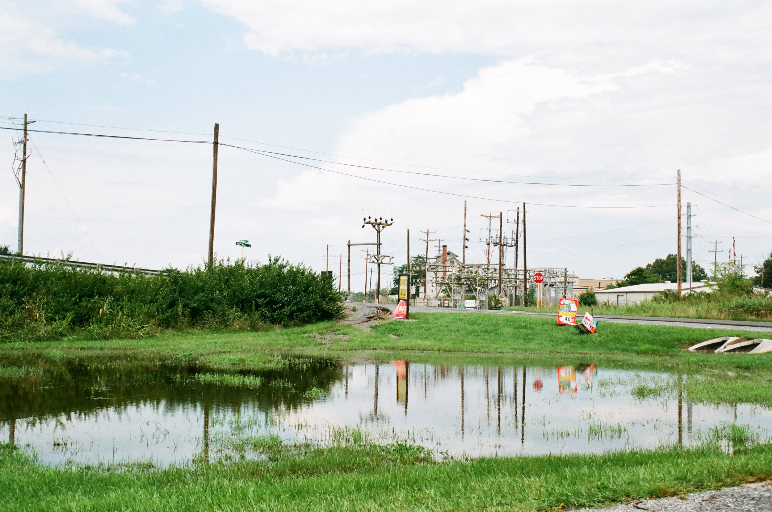 power grid and puddle after the rain on Fuji C200