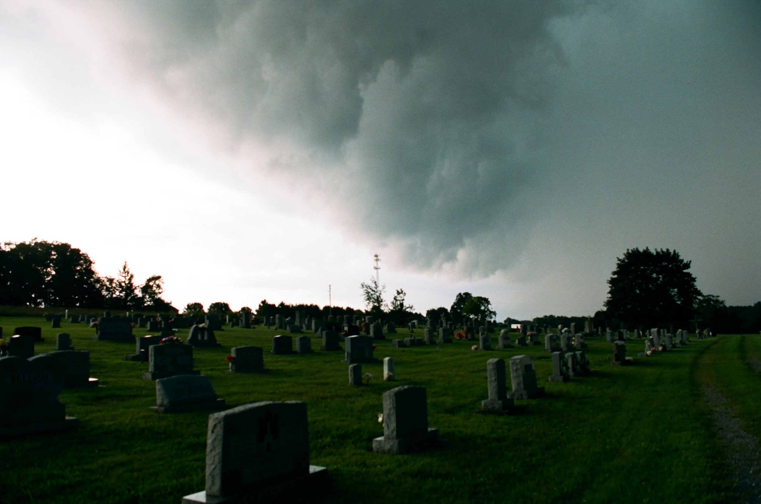 Shelf cloud at the edge of the precipitation just before strongest storm winds over cemetery on Kodak Portra 400