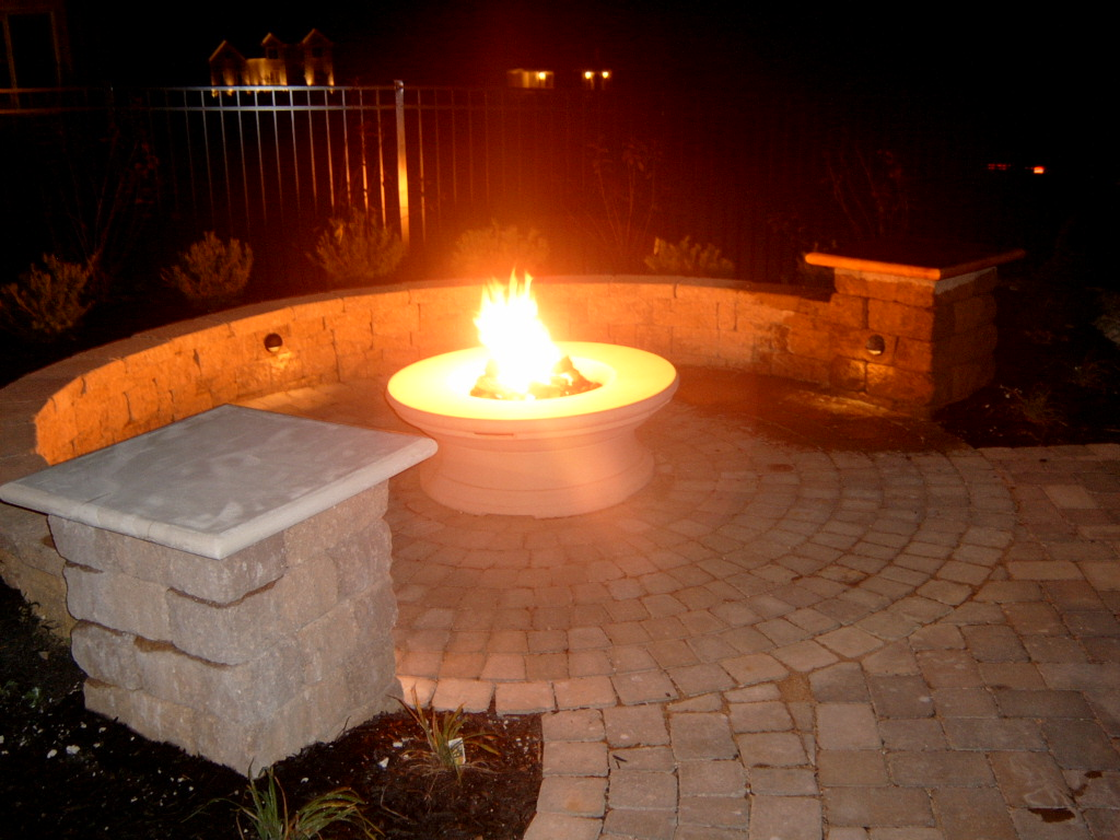 A nice fire pit facilitates good friends and times.
