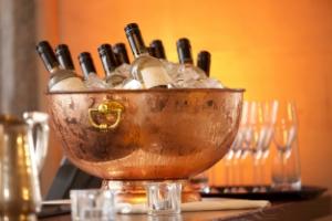 Wine bottles in ice bucket.156226487.jpg