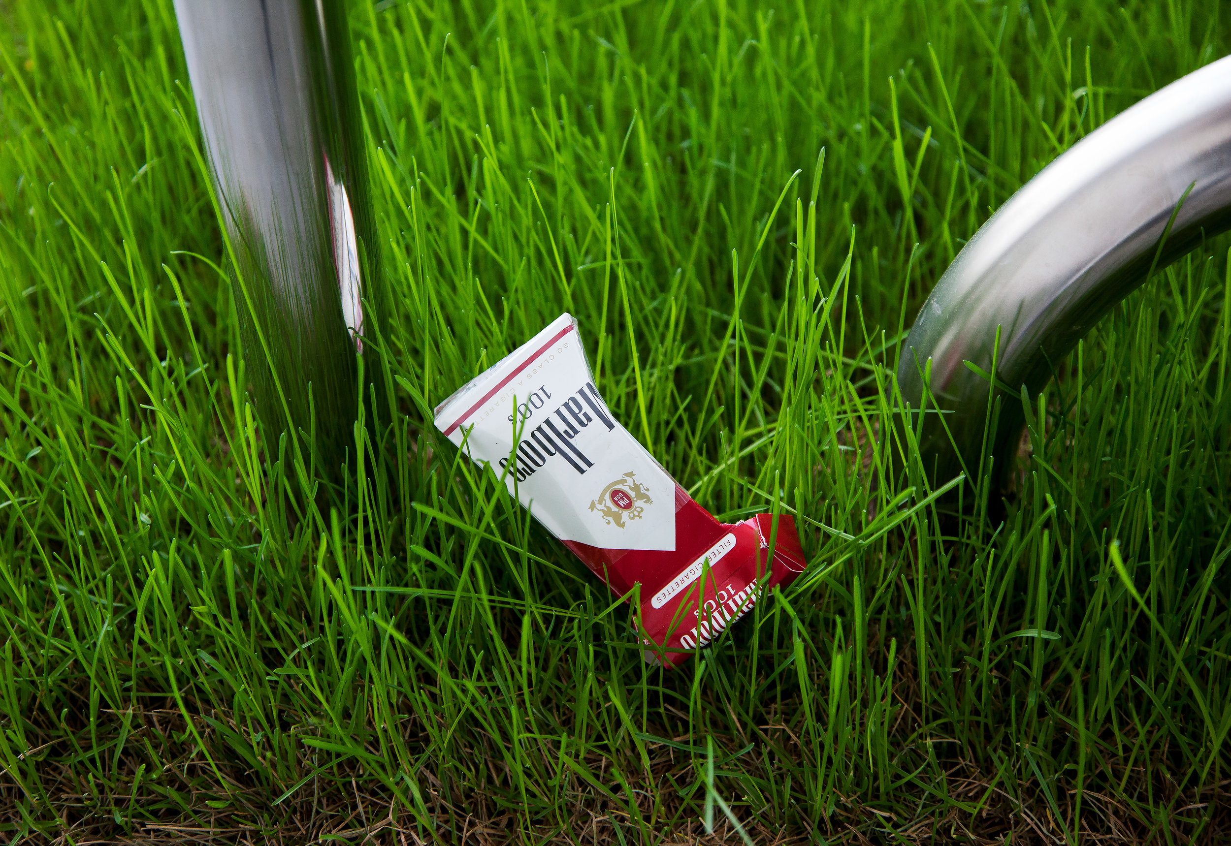 "Lawn Rails  ,  detail, 2014, stainless steel, grass, soil, wood base, one empty pack of Marlboro Reds 100's, 36""x 36"" x 36"" (91.4 cm x 91.4 cm x 91.4 cm)"