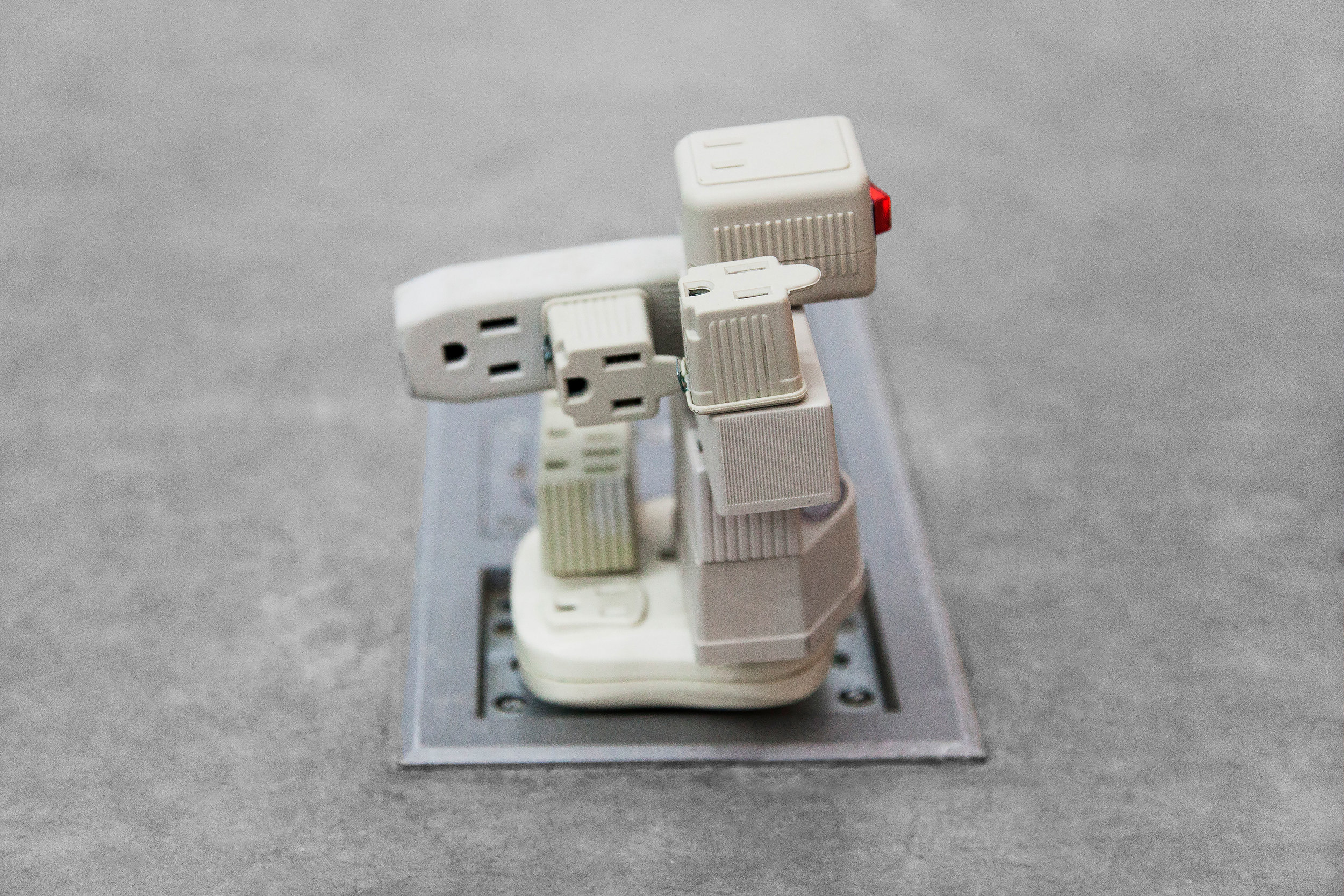 """Plugin Adapter , 2014, outlet adapters, 3""""x 3""""x 4"""" (7.6 cm x 7.6 cm x 10.2 cm)"""