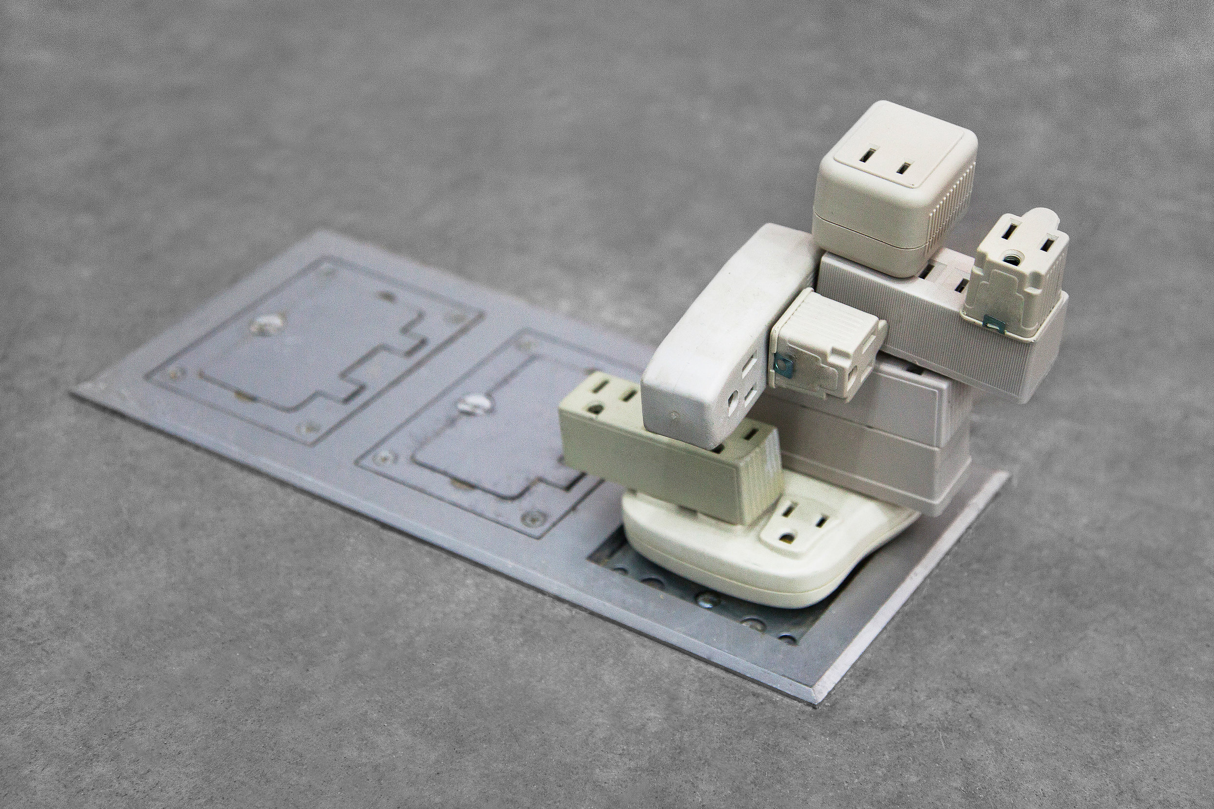 """Plugin Adapter , 2014, outlet adapters, 3""""x 3""""x 4""""(7.6 cm x 7.6 cm x 10.2 cm)"""