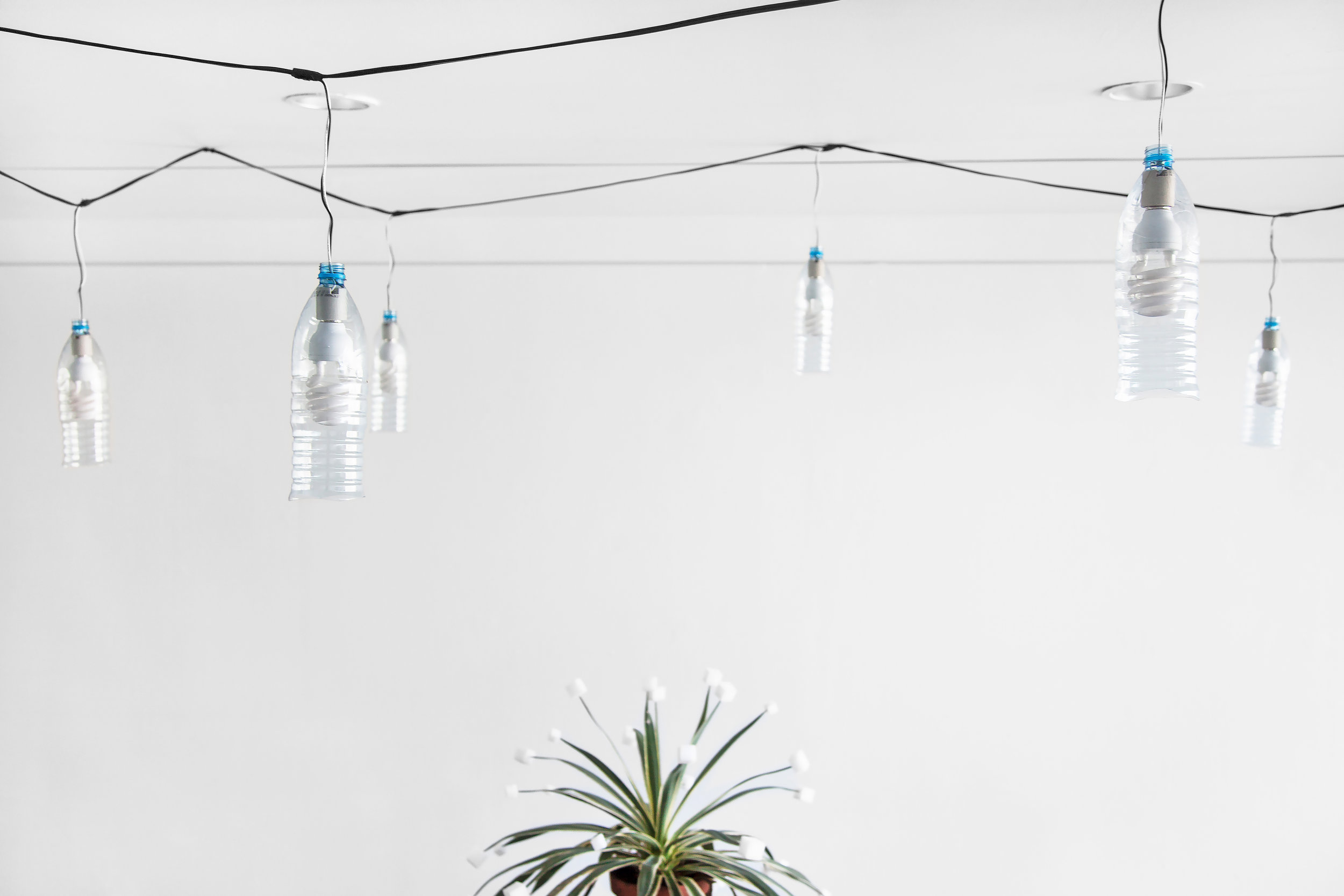 """String of Sohat , 2014, 22 Sohat water bottles, 22 60W daylight bulbs, weather proof cable/ plug, 48' (576"""" long, 14.6 m)"""