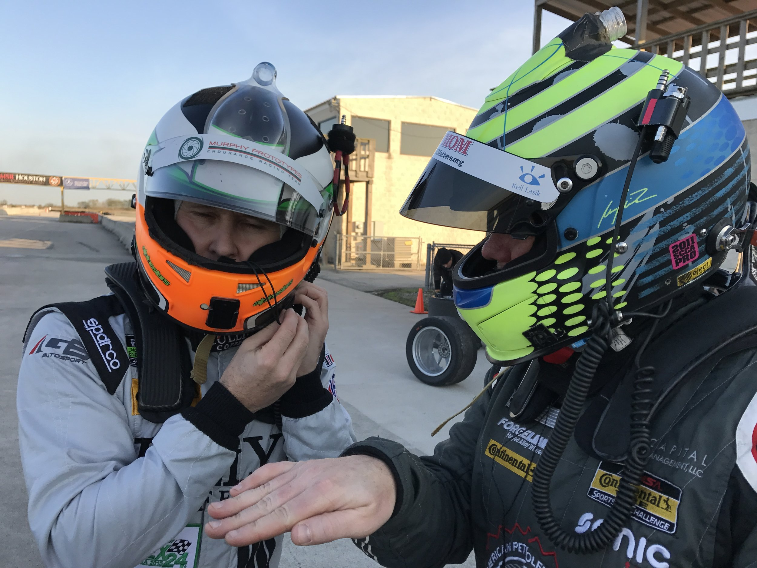 Damien Faulkner (left) gets some insight into the handling characteristics of the Cayman GT4 Clubsport from new teammate, Marc Miller, during testing in December at MSR Houston.