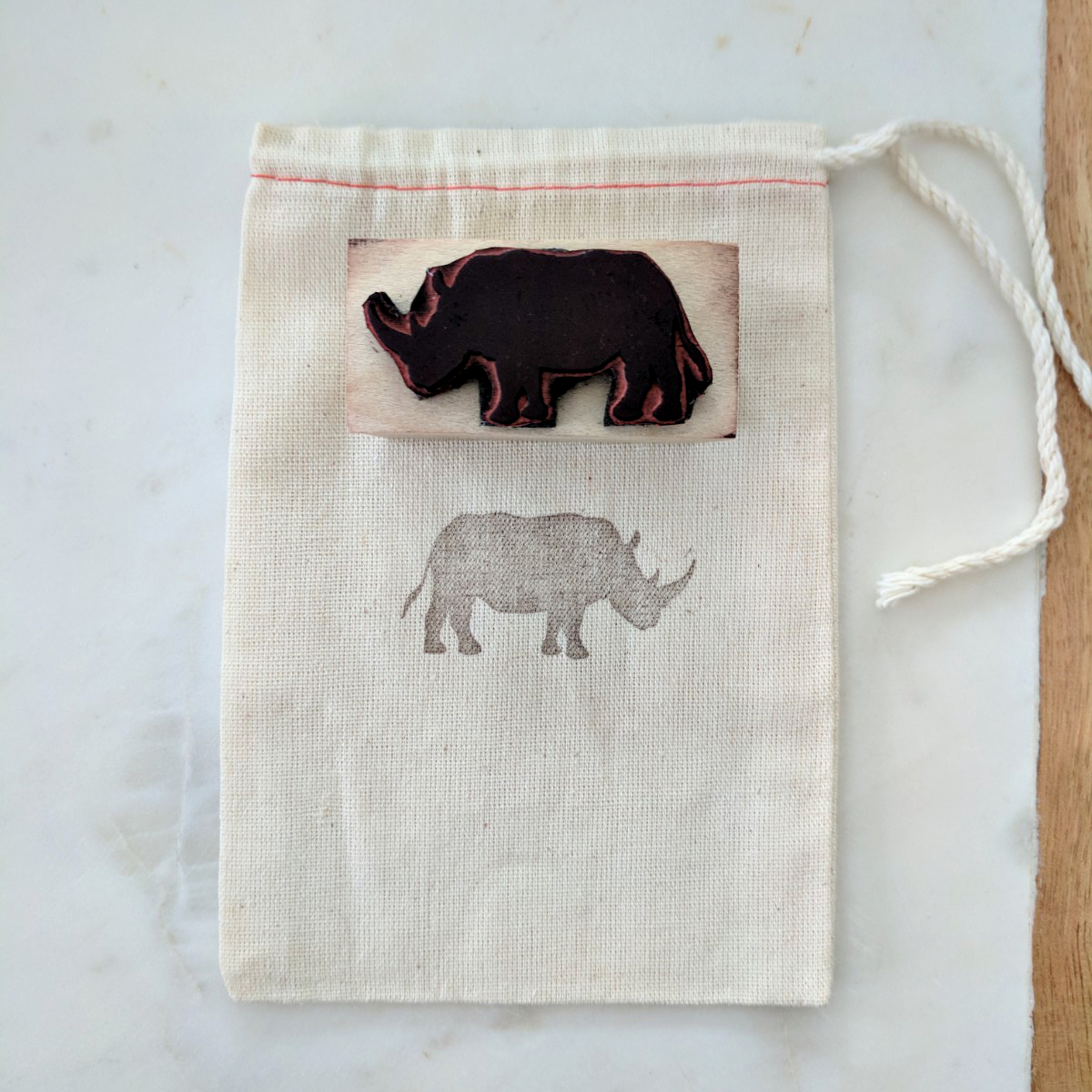 Cotton Bags - We package all of our rubber stamps and Christmas ornaments in cotton bags that are stamped with our rhino icon.