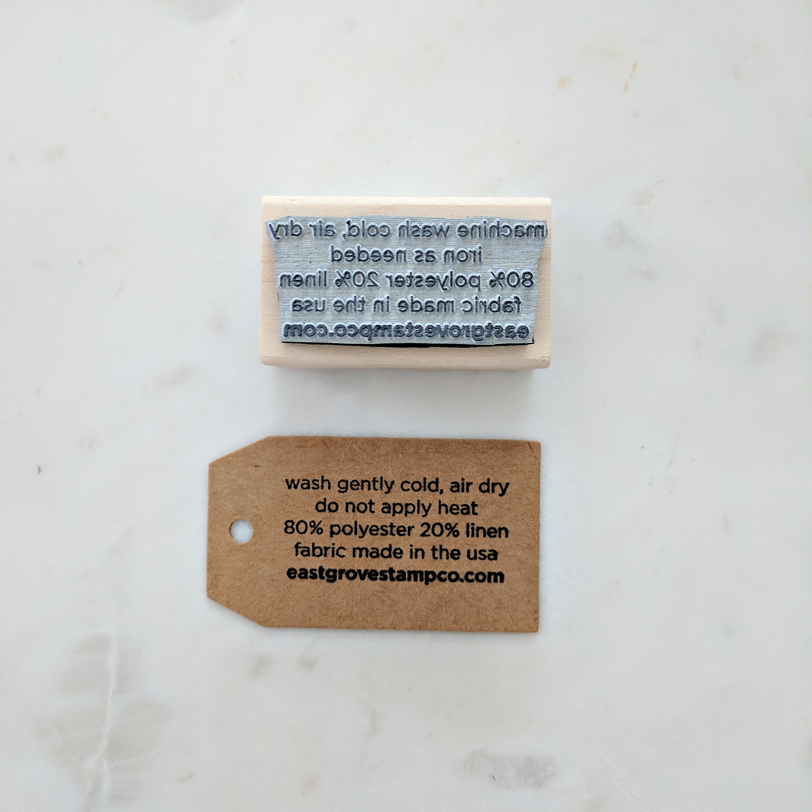 Fabric Tags - When we started working with fabric, we needed a way to call out the care instructions. These tags are attached to our fabric products in-lieu of a traditional sewn tag.