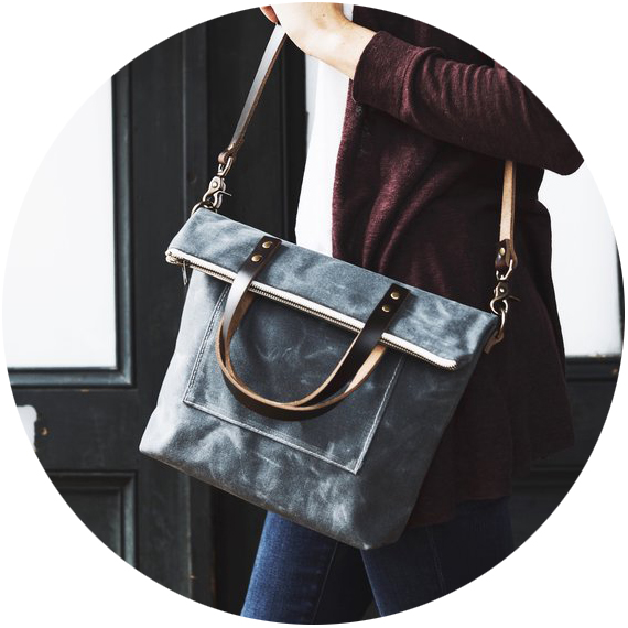 Red House  – part of the Carry Collection, these bags are made with waxed canvas, french ticking, horween leather, and solid antique brass hardware. This bag is essential for the mom who carries a lot and is beyond the diaper bag.