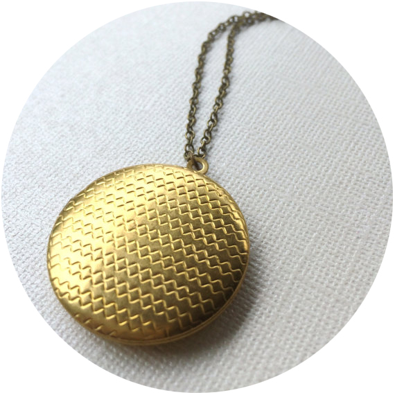 """Marigold Mary  – these lockets straddle the line between vintage and modern. I think lockets are a universally a cherished """"mom gift"""", just make sure you don't forget the pictures! I have gifted Marigold Mary's jewelry to both my MIL and SIL."""