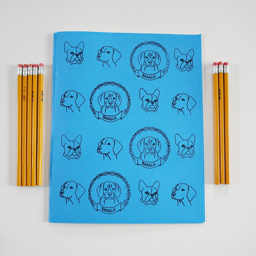 School supply shopping is less exciting nowadays when you're instructed to get your child a blue folder for math and a green one for science. Jazz up a plain folder with a fun patterns of pups. Here I combined both types of our  dog stamps .