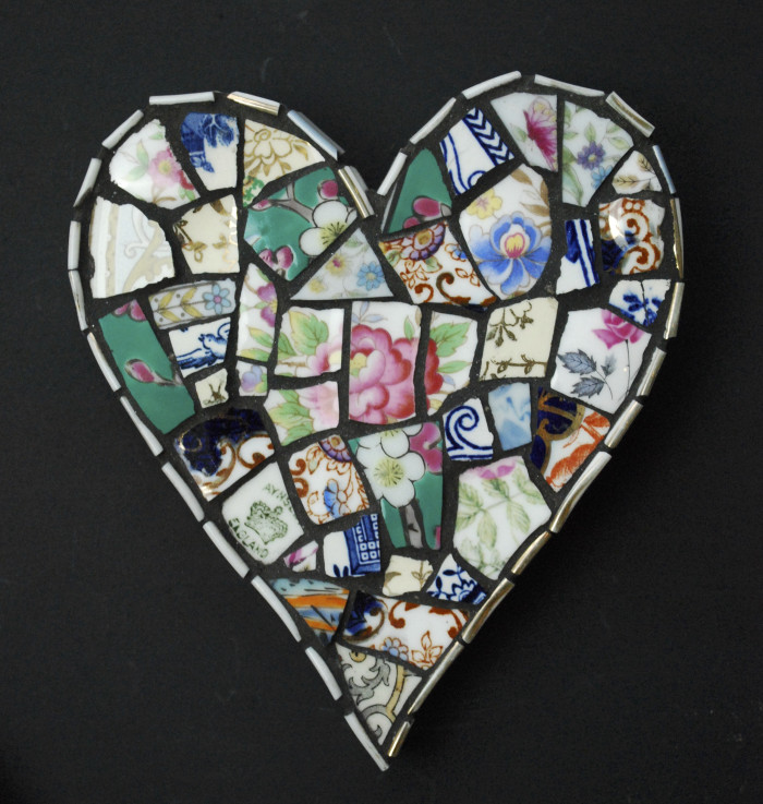 Mosaic heart worked in vintage china and finished with black grout