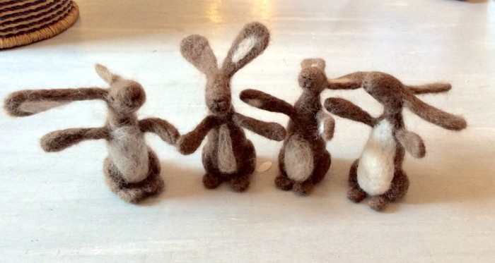 Close up of 4 needle felted hares