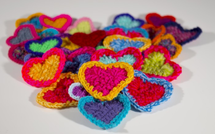 colourful crochet hearts all in a pile