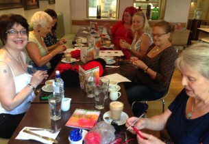 8 of the 'Carluccio's Crochet Ladies crocheting remembrance poppies.