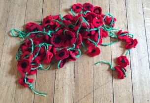 crochet remembrance poppies - waiting to be hung up