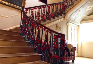 crochet poppies winding their way up the staircase of Bath Guildhall