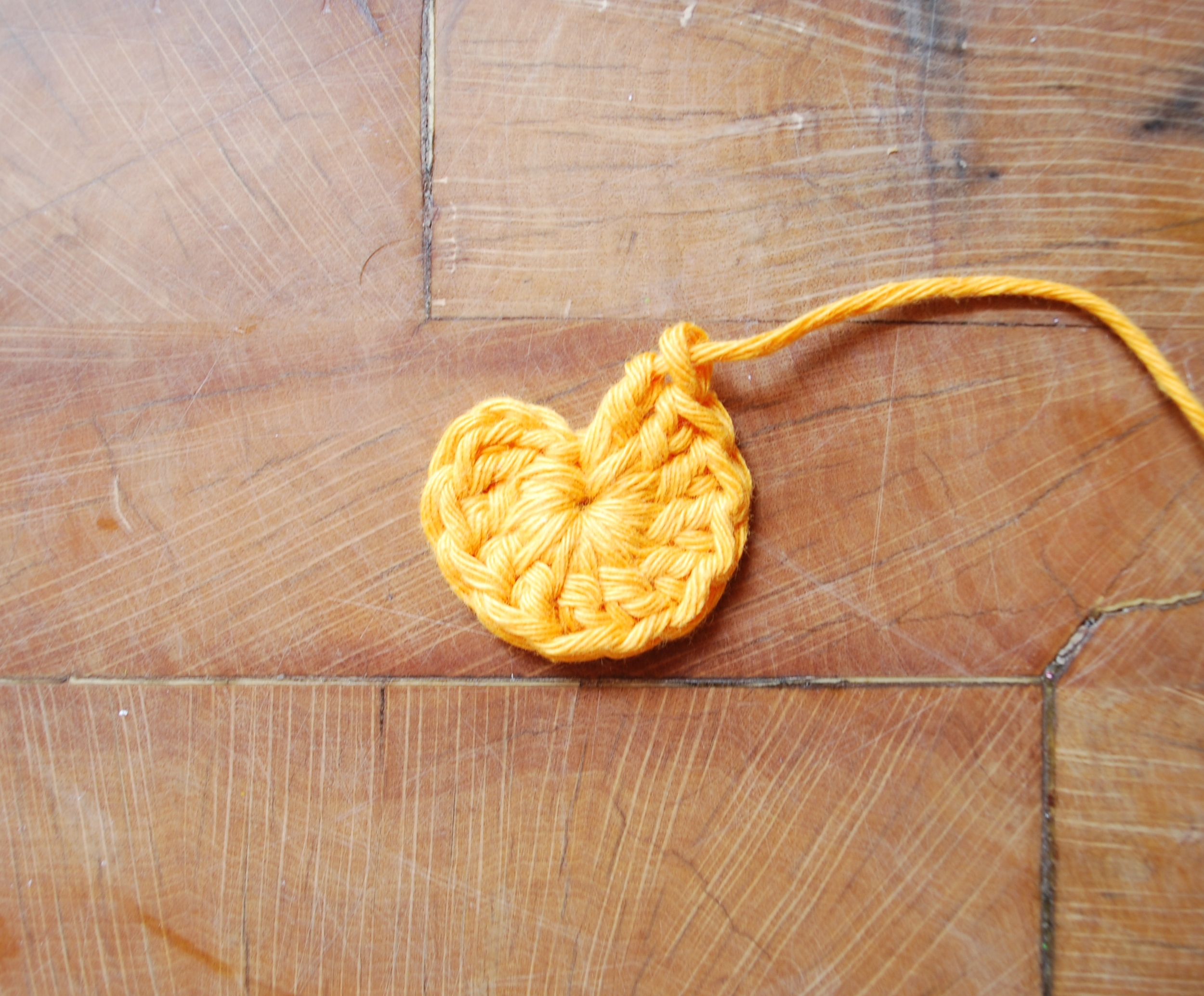 Cut your yarn and pull it all the way through.