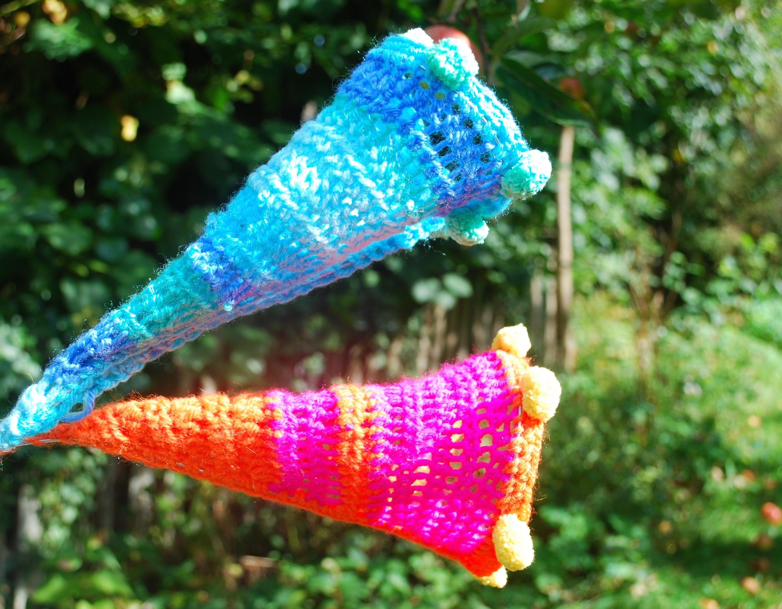 Sculptural crochet flowers in garden