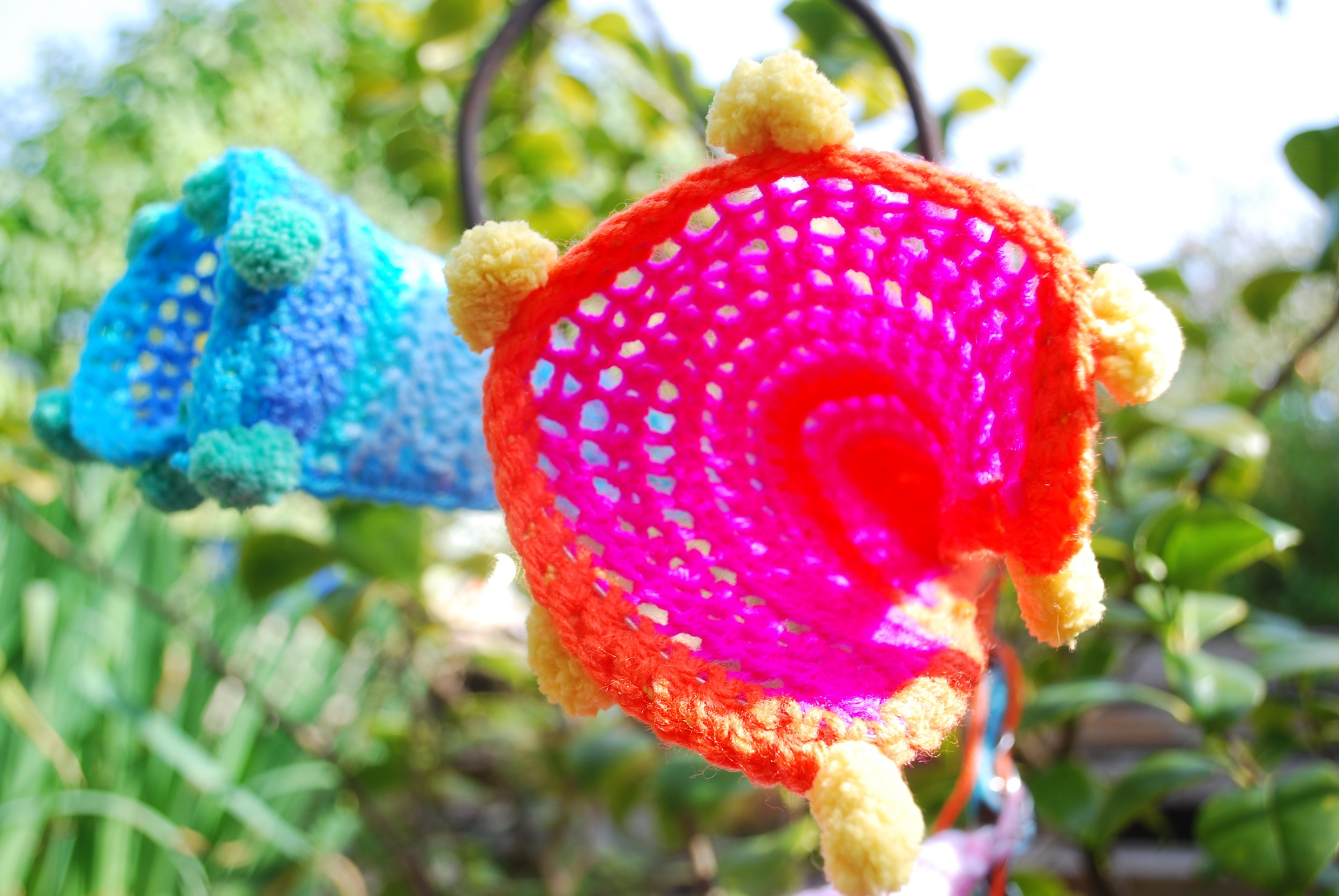 Sculptural crochet flower looking into the centre