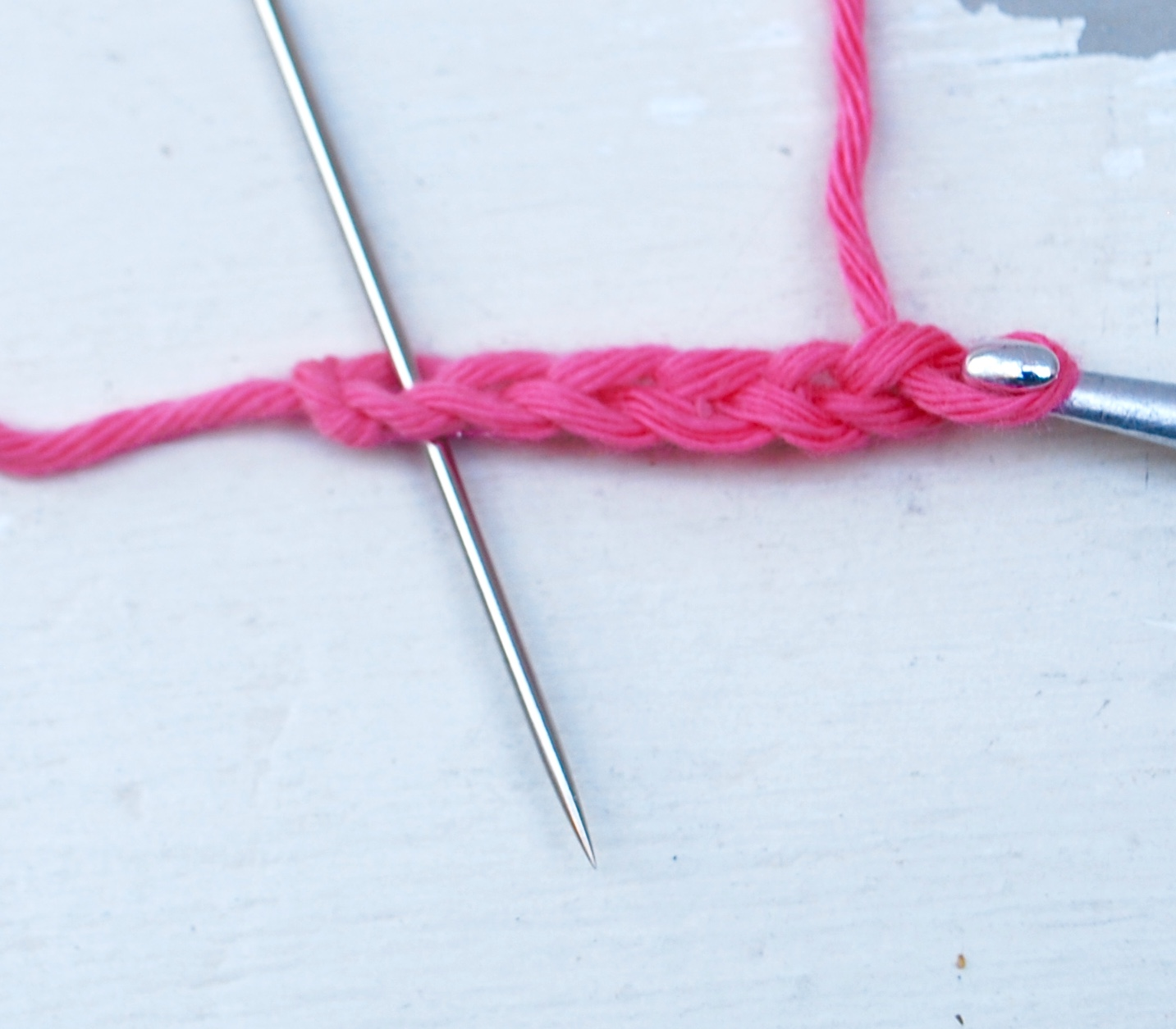 Chain 6 and join with a slip stitch into the first chain (as shown)to make a loop.