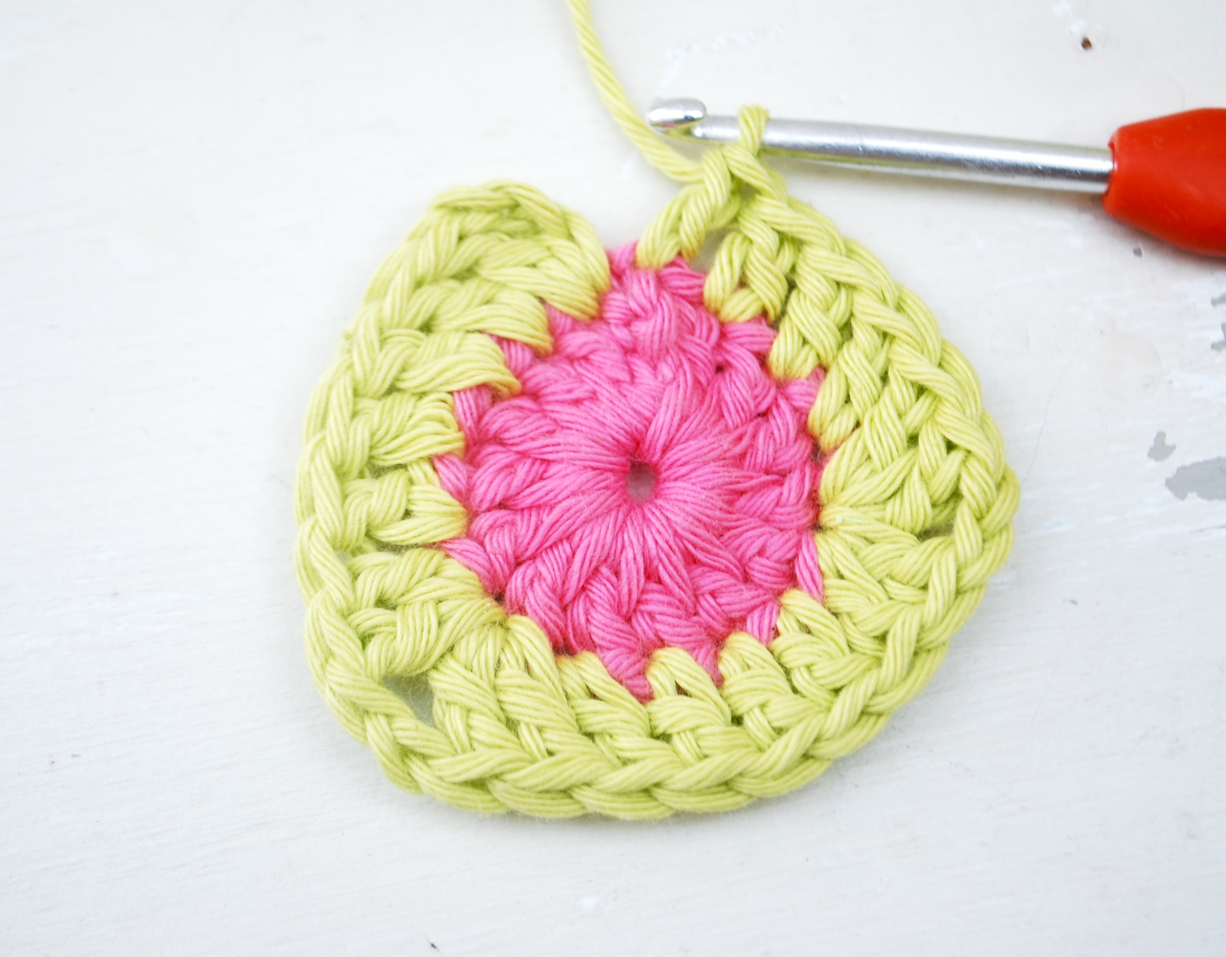 Work your second corner (2 treble crochet, chain 2 and 2 treble crochet all into same stitch) followed by 1 treble crochet into next 4 stitches.  This takes you to your 3rd and final corner (which is already half complete!)