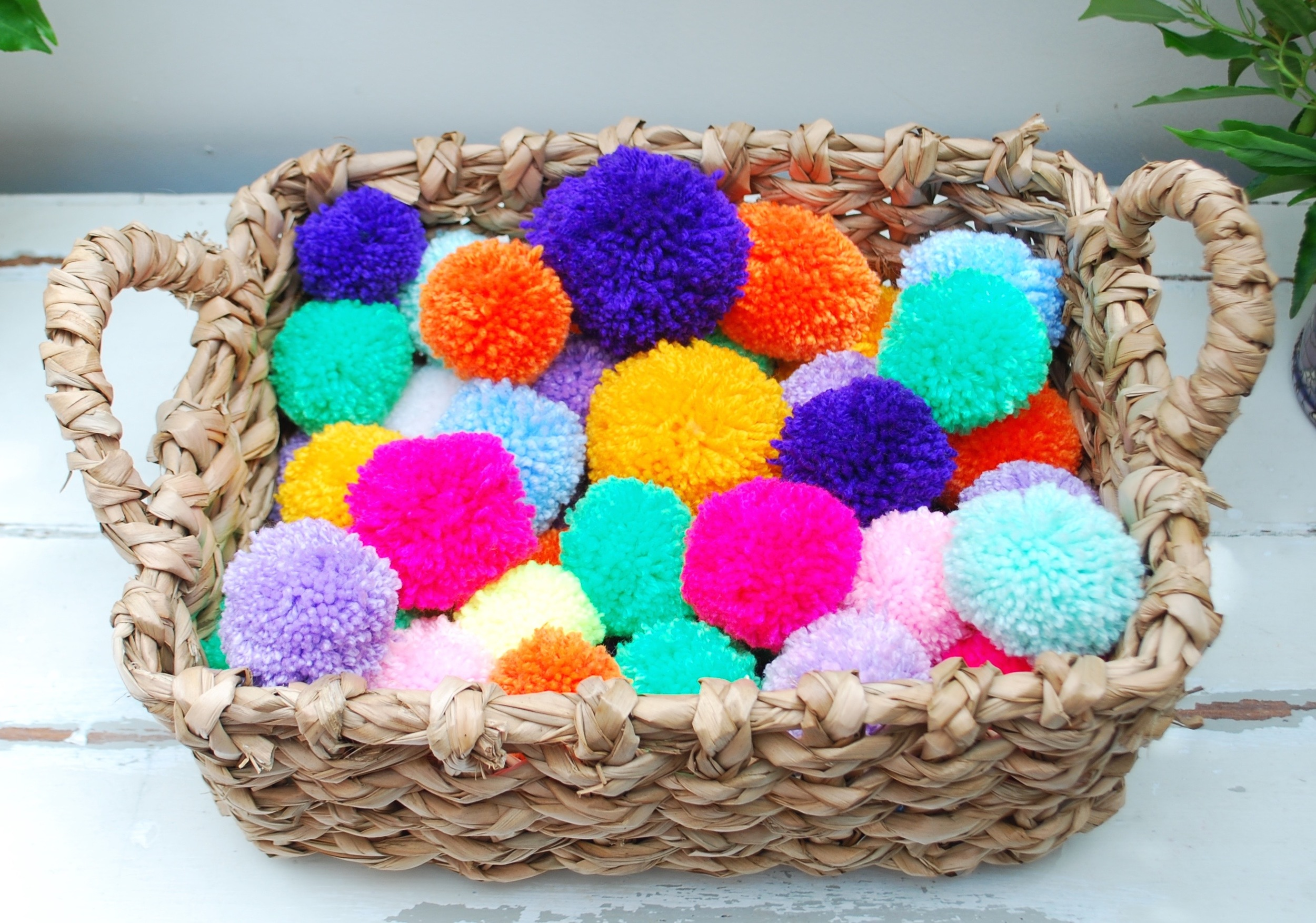 A basket of Pom poms